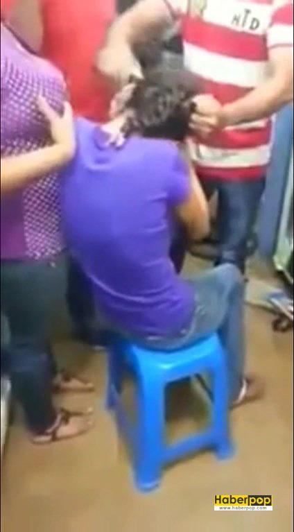 Hırsızlık-yapan-iki-kızın-saçları-mağaza-sahibi-tarafından-kesildi-video