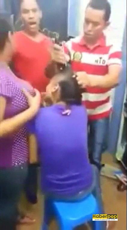 Hırsızlık-yapan-iki-kızın-saçları-mağaza-sahibi-tarafından-kesildi-videosu