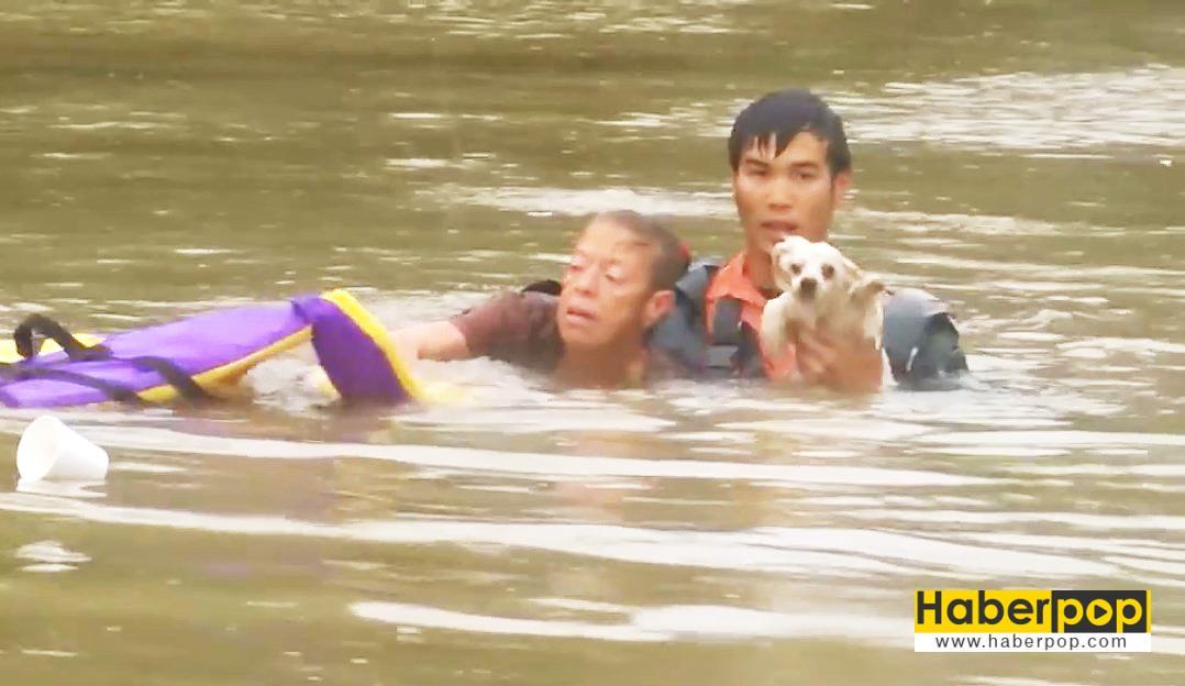 Selde-boğulan-kadını-ve-köpeğini-böyle-kurtardı-video-izle